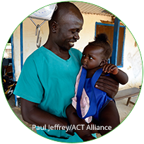 male health care worker holding a child